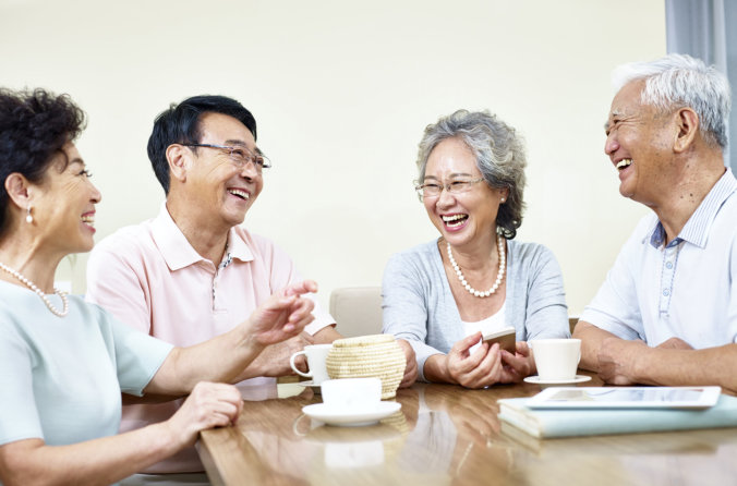 group of elderly couple smiling