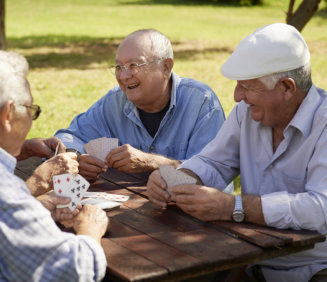 group of elder men playing cards